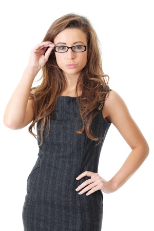 Attractive young businesswoman with specs wear grey elegant dress, over white background photo