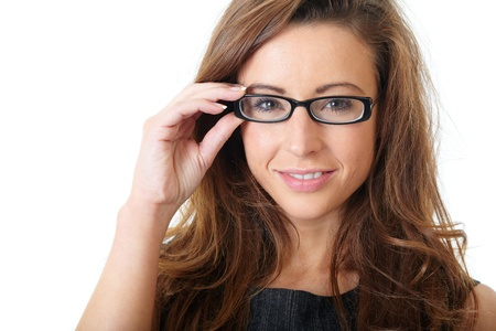 Attractive young businesswoman with specs wear grey elegant dress, over white background Stock Photo - 11477706