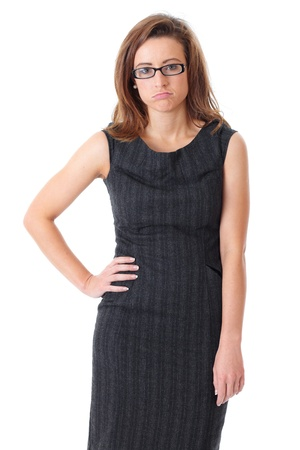 unconcerned: Young bored and tired businesswoman in black dress over white background