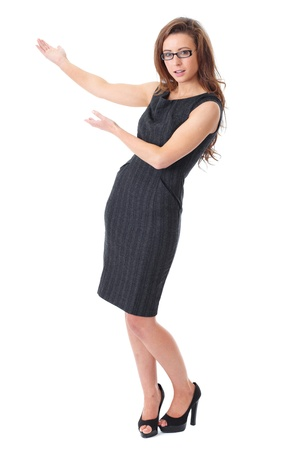demonstrate: Attractive female in dark dress presents something over white background
