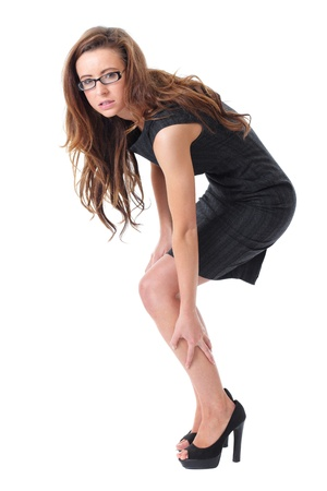 business woman legs: Young attractive businesswoman suffer from pain in her leg, isolated on white Stock Photo
