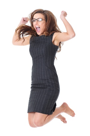 Happy young attractive businesswoman makes victory jump, isolated on white