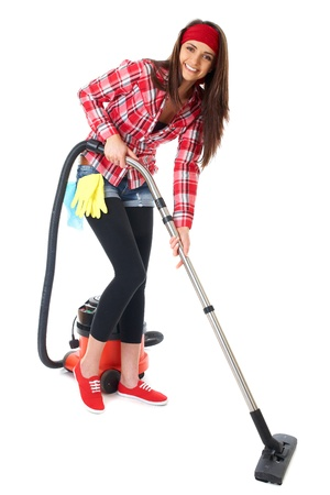 young attractive female cleaner in red shirt use vacuum cleaner, isolated on white background Stock Photo