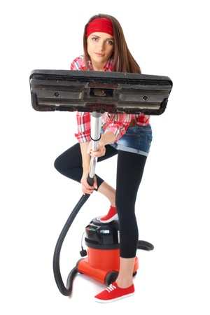 vacuum cleaner: young attractive female cleaner in red shirt use vacuum cleaner, isolated on white background Stock Photo