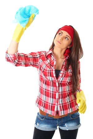 young attractive female cleaner in red shirt and yellow rubber gloves, isolated on white photo
