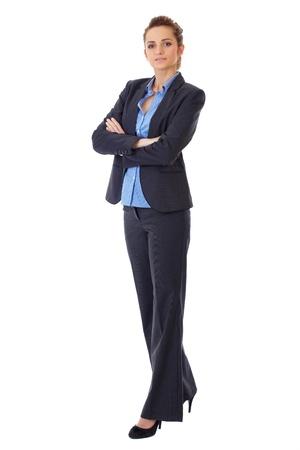 cuerpo entero: Atractiva mujer de negocios sesión de cuerpo entero sobre fondo blanco Foto de archivo