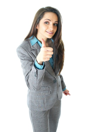 young attractive businesswoman shows thumbs up gesture, isolated on white background photo