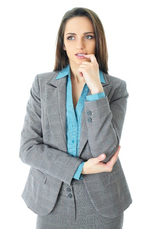 consider: young thoughtful businesswoman in grey suit and blue shirt, isolated on white background Stock Photo