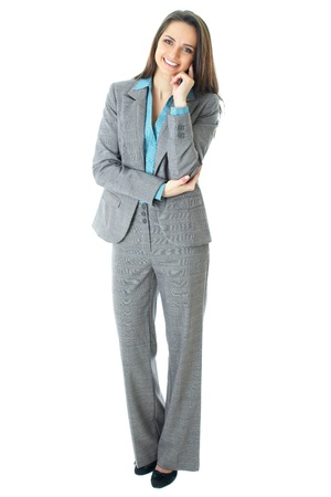 young thoughtful businesswoman in grey suit and blue shirt, isolated on white photo