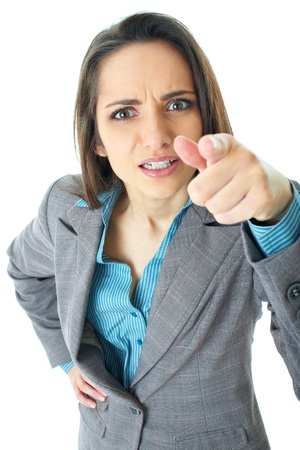 very angry businesswoman point her finger to camera, isolated on white photo