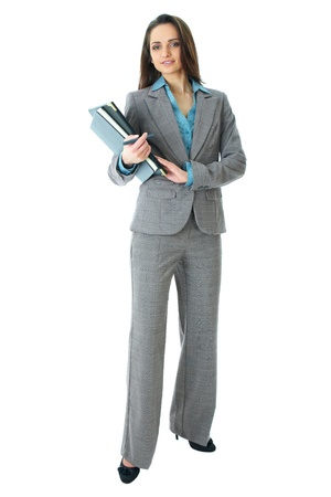 business woman standing: young attractive businneswoman in grey suit and blue shirt, full body shoot isolated on white background Stock Photo