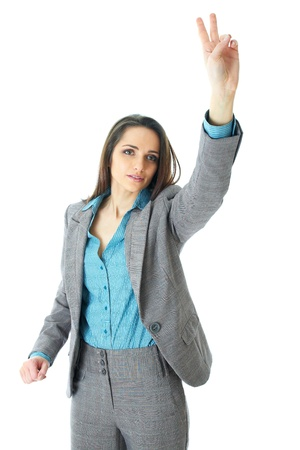 young elegant and attractive businesswoman rise her hand to get more attention, isolated on white background Stock Photo - 11477762