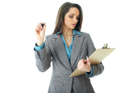 young attractive businesswoman draw in front of her while checking something in her notes, isolated on white background photo
