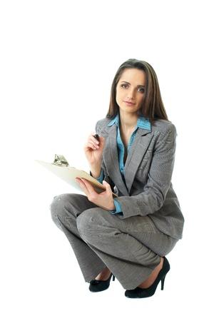 young attractive businesswoman draw in front of her, isolated on white background, crouch down pose Stock Photo - 11477728