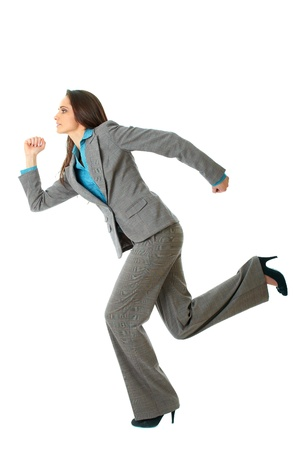 young happy businesswoman in a rush, run pose, isolated on white