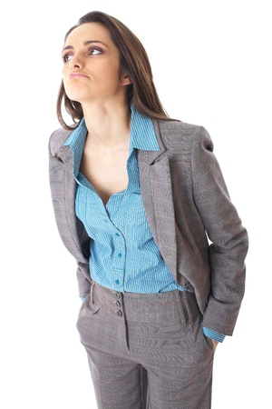dissapointed: young thoughtful businesswoman in grey suit and blue shirt, isolated on white