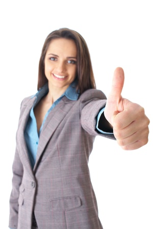young female shows thumb up gesture, wears blue shirt and suit, focus on thumb, isolated on white Stock Photo - 11477723
