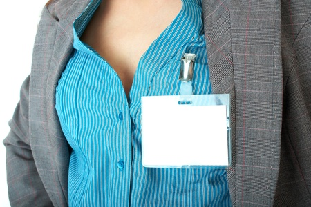 white blank name badge, blue shirt and grey suit
