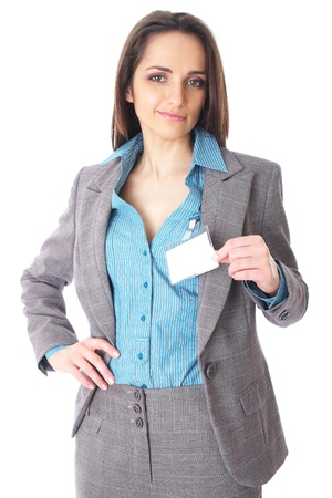 attractive female holds blank name badge, wears blue shirt and suit, isolated on white background photo