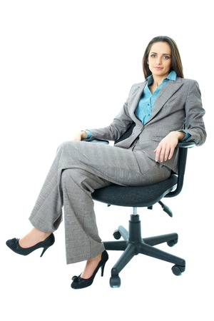 sits on a chair: young attractive businesswoman sits on office chair, isolated on white background