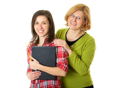 happy and smilling mother and her student daughter, studio shoot isolated on white Banque d'images