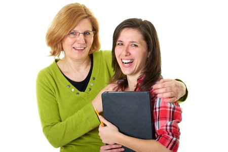 smilling: happy and smilling mother and her student daughter, studio shoot isolated on white Stock Photo