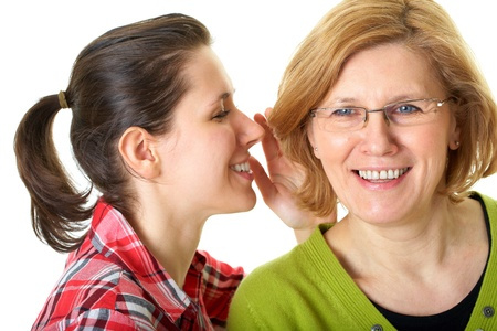 daughter whisper something to her mother, secrecy or privacy concept, isolated on white background Archivio Fotografico