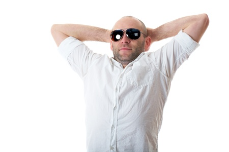 relaxed young guy in sunglasses with hands behind his head, stretch, break time, isolated on white photo