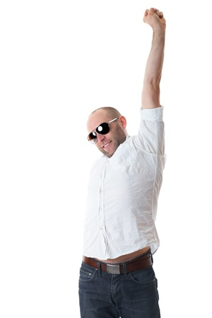 attractive relaxed young guy in sunglasses stretch his arms, isolated on white background photo