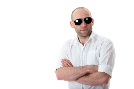relaxed young guy in sunglasses with hands crossed on his chest, isolated on white background photo