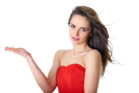 young attractive brunette female in red strapless dress, empty hand concept, isolated on white Stock Photo - 11477909