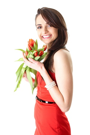 young female in red dress with bunch of red tulip flowers, studio shoot isolated on white photo