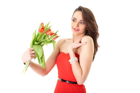young female in red dress receive bunch of red flowers, isolated on white photo