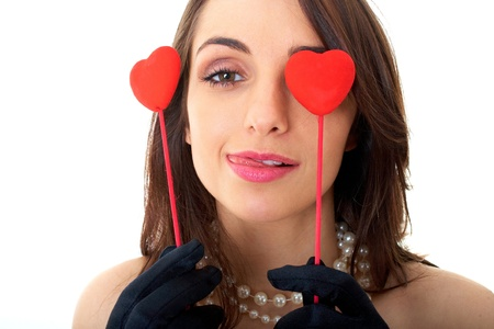 brunette in red dress holds two hearts, isolated on white Stock Photo - 11478060