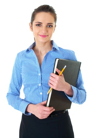 young happy female in blue shirt holds black notepad and yellow pencil, isolated on white