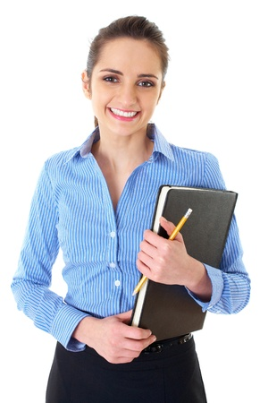 young happy female in blue shirt holds black notepad and yellow pencil, isolated on white photo