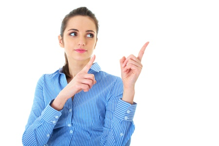 attractive brunette businesswoman points her fingers up and to the side, isolated on white Stock Photo - 11477915