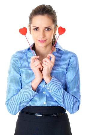 businesswoman in blue shirt holds two small hearts, studio shoot isolated on white Stock Photo - 11478074