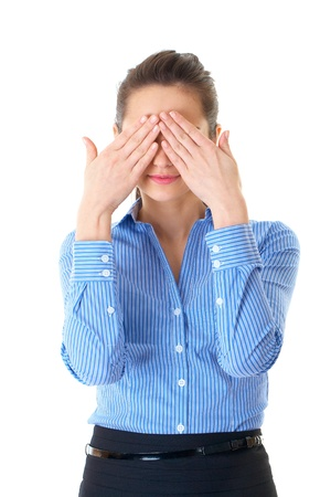 businesswoman covers both eyes, blue stripped shirt, isolated on white photo