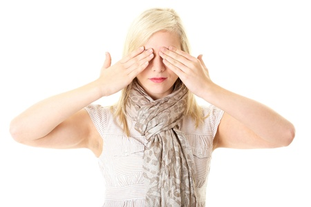 hand covering eye: blonde young female cover her eyes with her hands, isolated on white Stock Photo