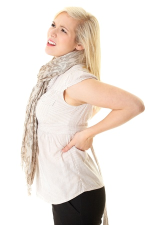 blonde female with backache, isolated on white photo