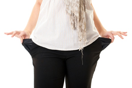 black pants: female holds her empty pockets, debt concept, isolated on white Stock Photo