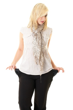 broke: moneyless, blonde female shows empty pockets, isolated on white Stock Photo