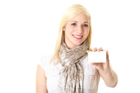 young blonde female holds white blank business card, isolated on white photo