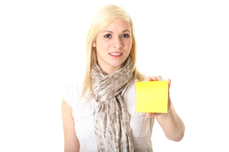 young blonde female holds yellow note card, studio shoot isolated on white photo