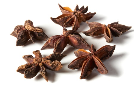 star anise on white table photo