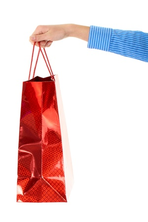 gift bags: female hand holds red gift bag, isolated on white