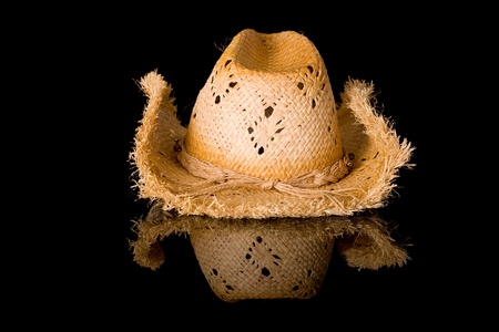 headgear: straw hat, front view, studio shoot isolated on black with reflection