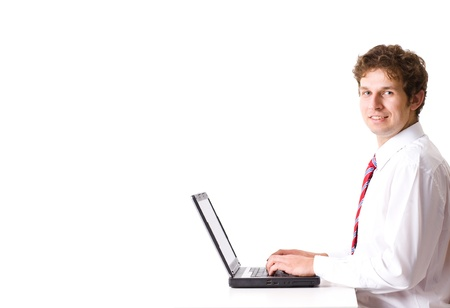 young businessman work on his laptop, studio shoot isolated on white photo