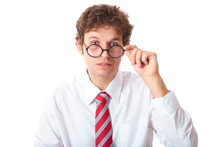 young surprised businessman holds his glasses, isolated on white background photo